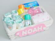 cesta recién nacido con pañales